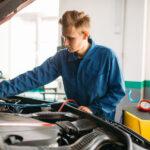 Mechanic Working on Car AC